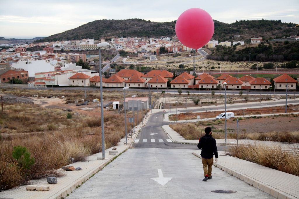 Preparing to capture aerial images with a ballon in an abandoned urban area in La Vall d'Uixó, Valencia, Spain, credit: Basurama.